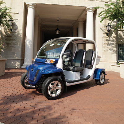 GEM<sup>&reg;</sup> e4 Electric Car - This vehicle is perfect for visiting family and friends or just recreational driving. Features seating for 4 people, a sunroof and six 12-volt flooded electrolyte batteries for a range of up to 30 miles on a charge. It's economic and environmentally friendly!