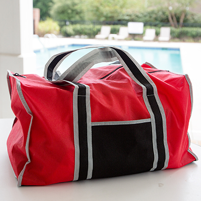 TOPPERS™ Enviro Friendly Duffel Bag - This eco-friendly reusable duffel bag features a large main compartment with reinforced bottom and zippered closure, an outer pocket and 24
